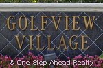 sign for Village on the Green / Golfview Village